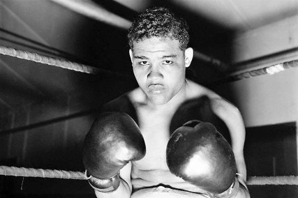 "Original caption: 6/5/38- Pompton Lakes, NJ - Just take a look at these two mighty ""pile drivers"" which Heavyweight Champion Joe Louis exhibits in this unusual closeup at his training camp, here. Louis is getting in trim to defend his title against Max Schmeling of Germany at the Yankee Stadium, June 22nd. Former Champion James J. Braddock, whom Louis defeated for the title, visited the ""Bomber"" at his camp, today, and placed his stamp of appoval on the title-holder. June 5, 1938 Pompton Lakes, New Jersey, USA"